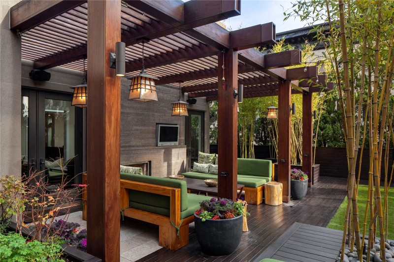 Beautiful-Terrace-With-Green-Sofa-And-Pergola-From-Wood-Plus-Classic-Pendant-Lamp