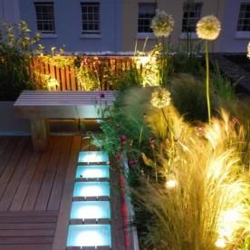 wooden-floor-garden-lounge-space-with-lighting-945x629